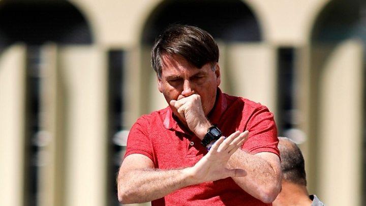 Photo of Brazil's Jair Bolsonaro ordered to wear mask in public