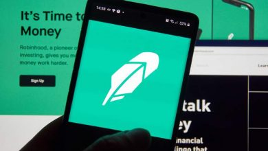 Photo of Robinhood says it has temporarily curbed the purchase of some securities, with deposit requirement increased tenfold